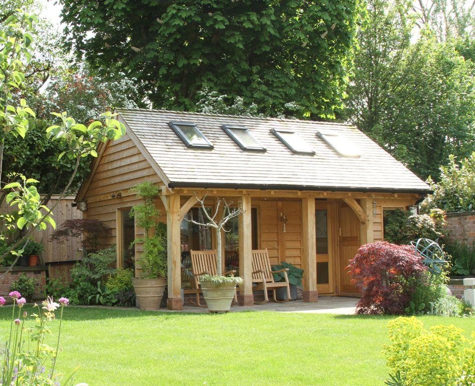 Best A Summerhouse Office Garden Equipment Store Cedar Shingle Roof Summer House Garden 400 x 300