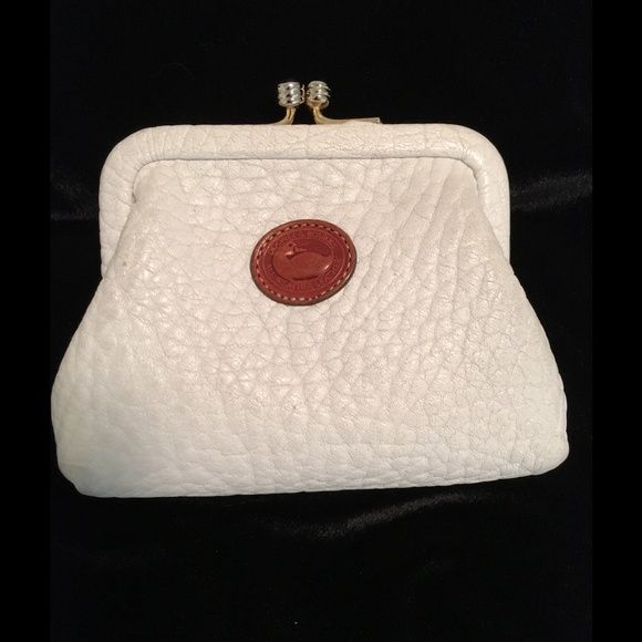Dooney & Bourke All Weather Leather Coin Purse Very good condition. Light, even soiling on exterior, commensurate with some usage. Bottom corners have a bit more discoloration but no wear.  No stains or tears in the leather. Interior has no rips only metal marks as it was used for coins! See photo. No damage to kiss lock or top, see photo.  This is a rare vintage item, please ask questions before purchasing. Dooney & Bourke Bags Wallets