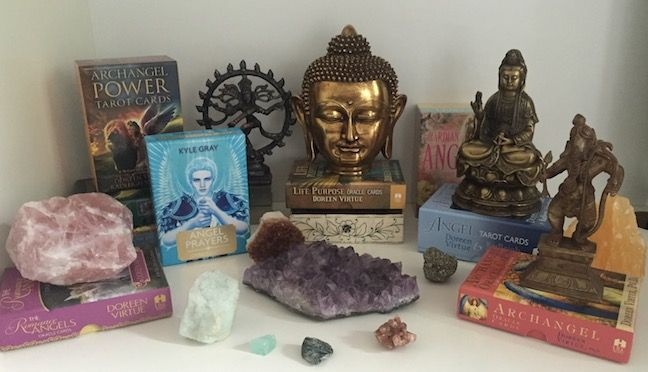 My Angel Cards and favourite statues with a few of my crystals