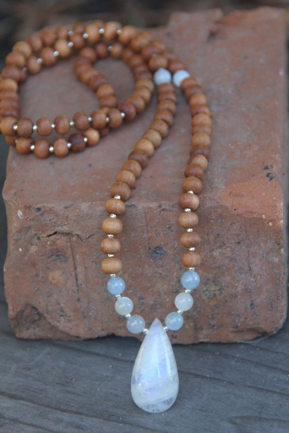 Beautiful large 32mm long natural moonstone with natural pink jade, rhodochrosite, and garnet accents and 7mm sandalwood beads. Contains 108+1 beads. Designed for meditation and yoga inspired. Mala length is 31 inches.  Moonstone is 32mm or 1 1/4 inches. Hand drilled by me! It has shades of light blue in the changing light. VERY beautiful!!   ♥ Happiness ♥ Good fortune ♥ Nurturing ♥ Mothering ♥ Unselfishness ♥ Humanitarian ♥ Love ♥ Hope ♥ Spiritual insight ♥ Easy childbirth ♥ Safe travel ♥…
