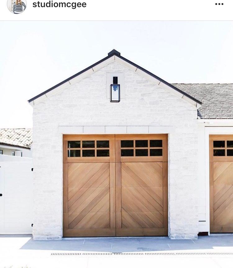 If We Have To Do Brick I Want White With Cedar Doors Black Metal Roof Like This And Black Window Modern Farmhouse Exterior Garage Door Design House Exterior