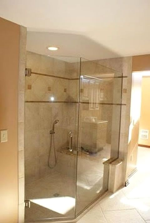 Custom frameless, angled glass shower wall by Patriot Glass and ...