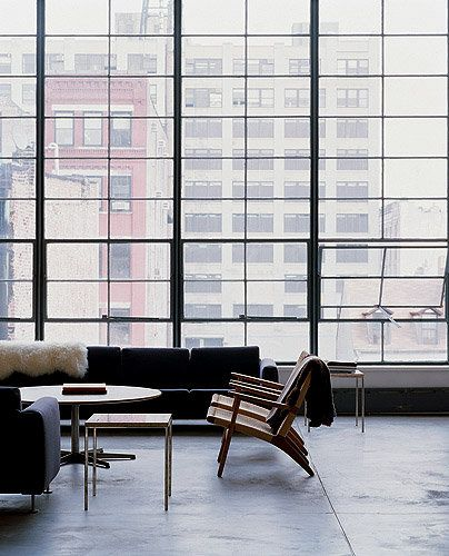 Loft With Huge Windows In The City With Concrete Floors