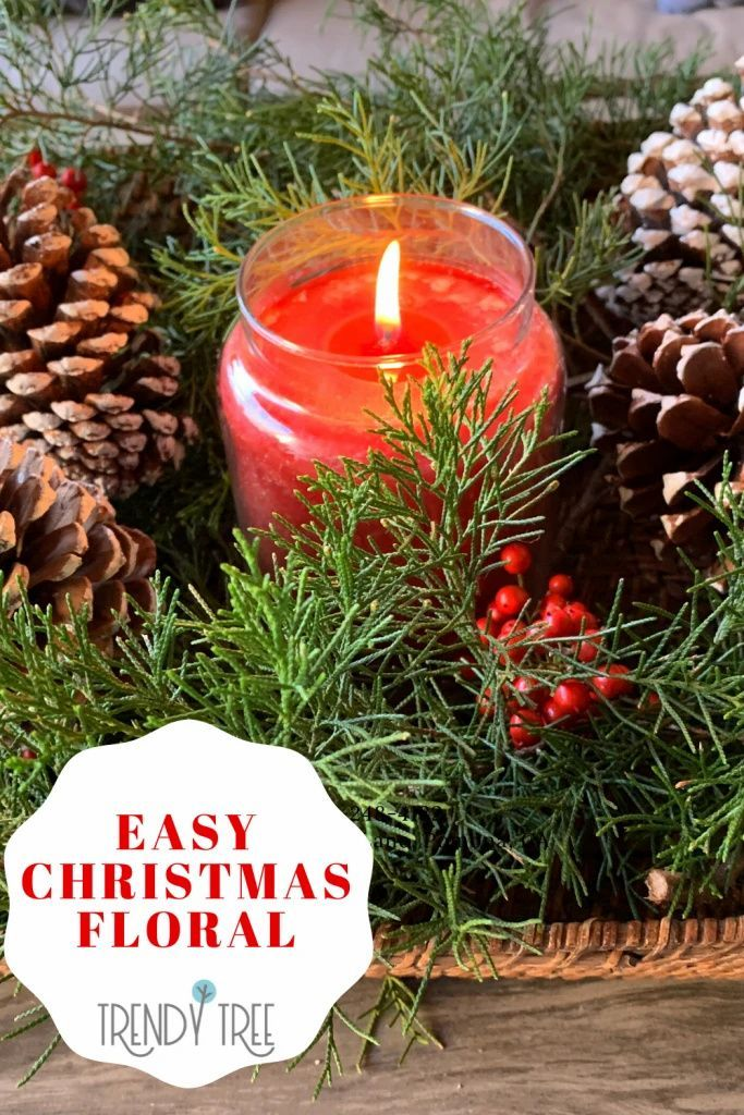 Bring tidings of comfort and joy with this easy Christmas floral display. It uses cedar branches, pinecones, and a red candle to create a simple and elegant Christmas centerpiece. Get your holiday decor inspirations at Trendy Tree.