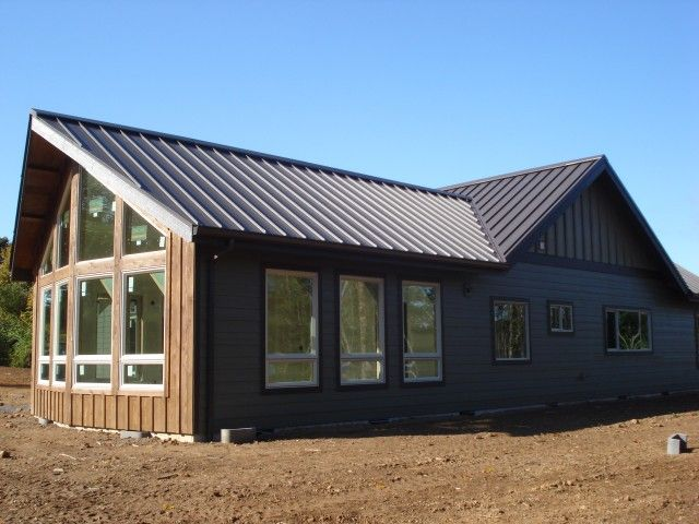 Metal homes on pinterest metal buildings modern barn for Images of houses with metal roofs