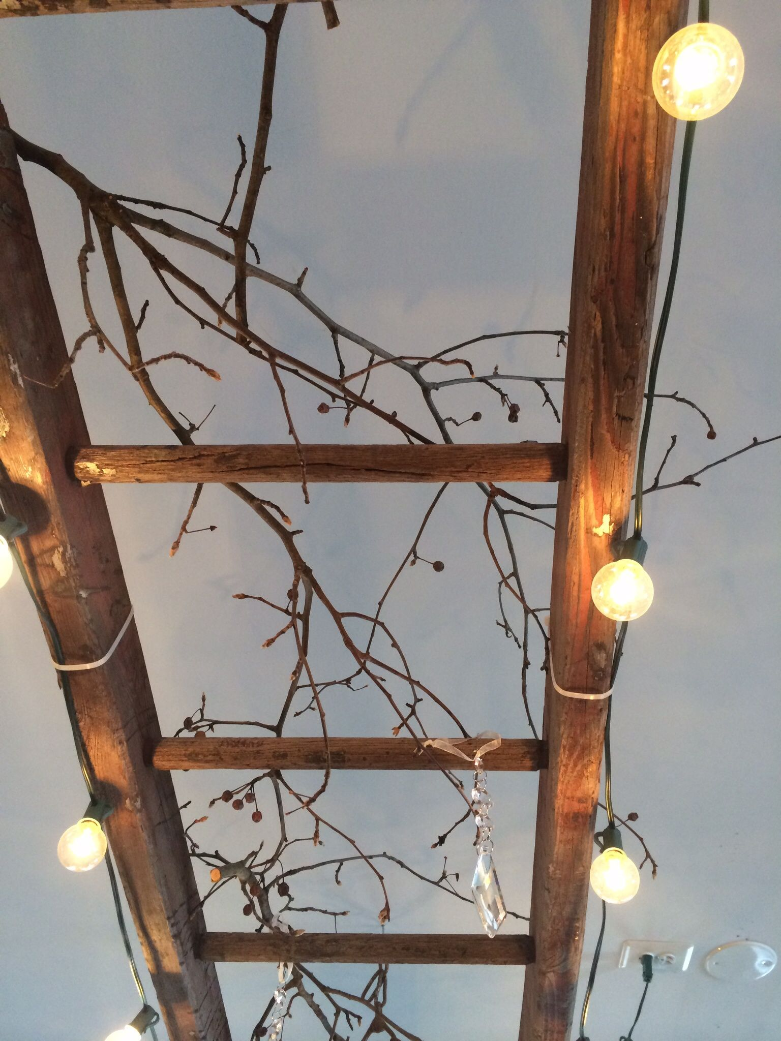 A Vintage Wooden Ladder Makes Great Lighting This One Is