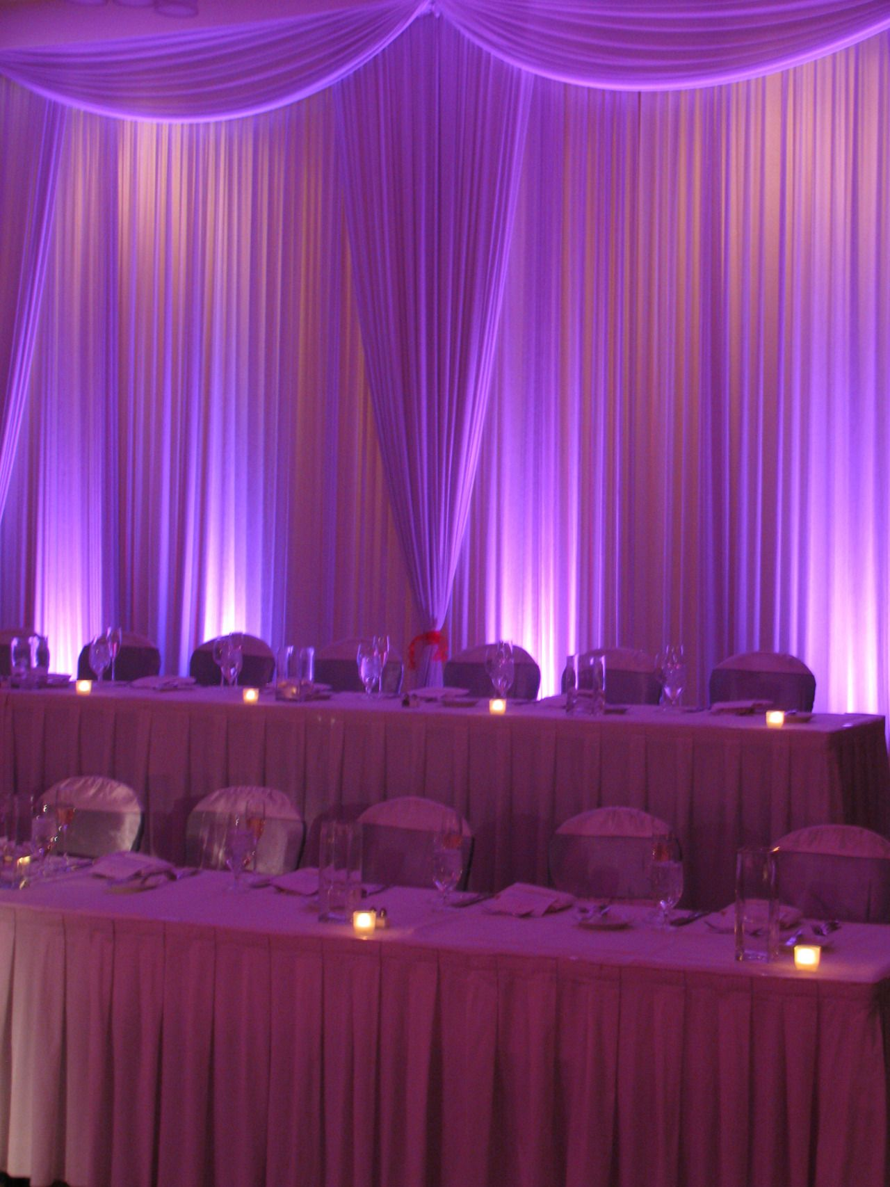 Gorgeous head table backdrop with curtains and uplighting. #uplighting #wedding #headtable #curtain | My dream wedding | Pinterest