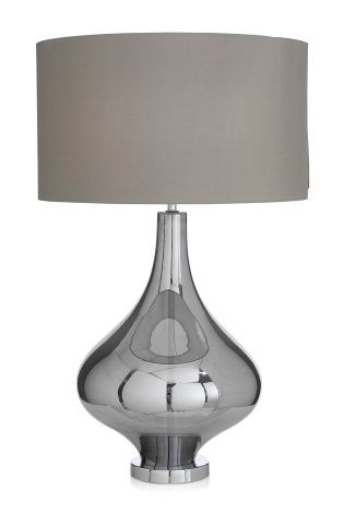 Lighten up your bedside or a corner table with stylish table lamps and bedside lights in host of finishes from next