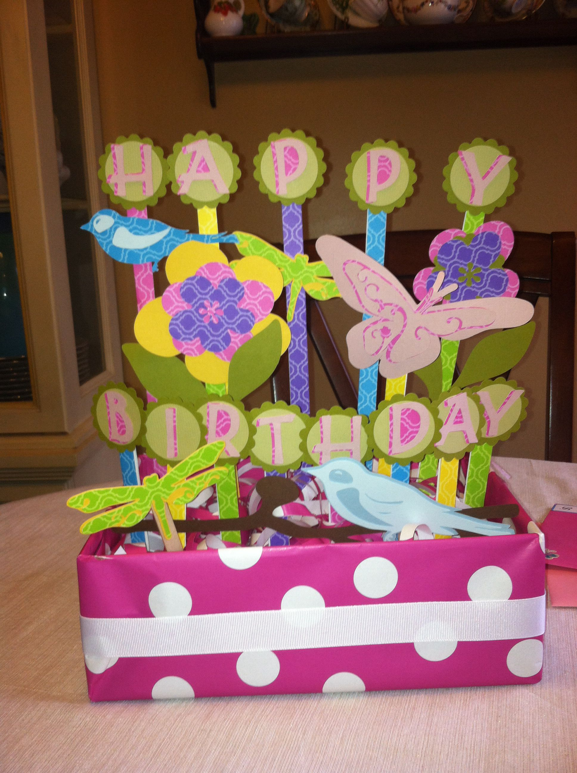 Barb'.Birthday centerpiece ... Worked with what I had.  Wrapped a shoe box in wrapping paper a piece of ribbon and then used the cricut and punches.