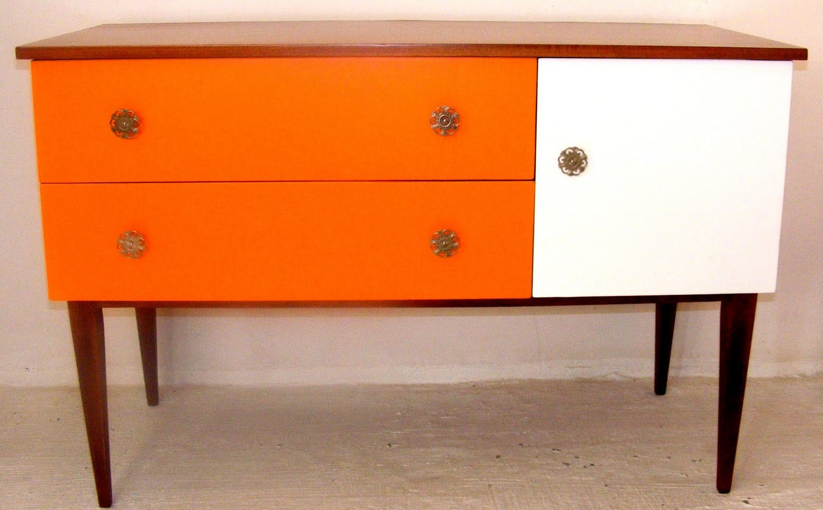 Sideboard With White And Tangerine Accents And Original Flower