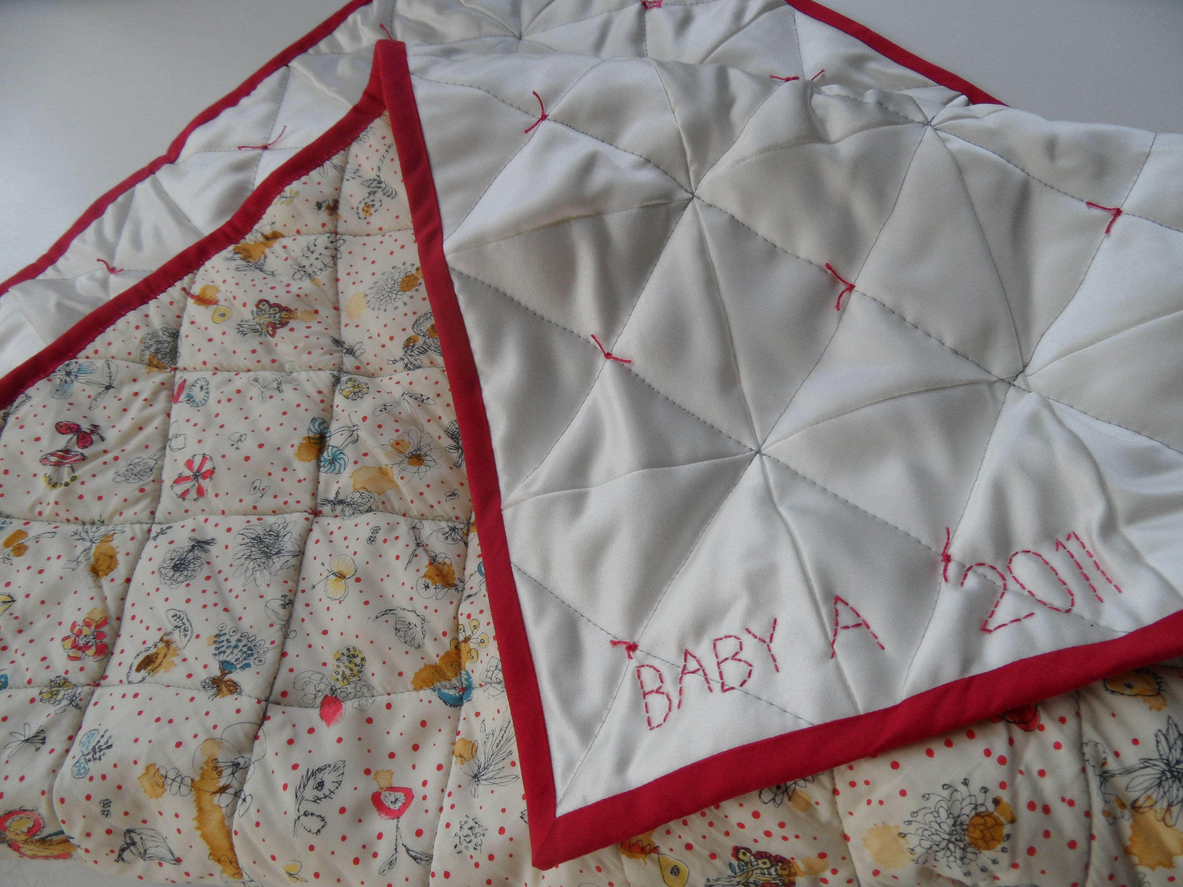 upcycled wedding dress becomes baby quilt http archiesboutique