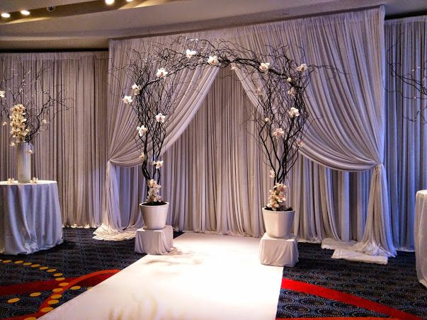 Ceremony @ Marriott Oakbrook - Fabric backdrop, black curly willow arch with white orchids and hanging candles, and aisle runner for a black and white themed colored wedding. #studioag #studioagdesign #chicagoweddings