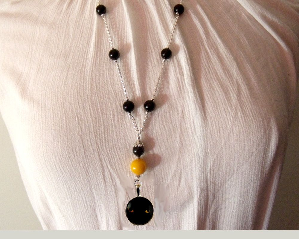 Long beaded necklace-Black Cat with yellow eyes,black agate beads, amber yellow jade and glass cabochon by CapricesDeParisienne on Etsy