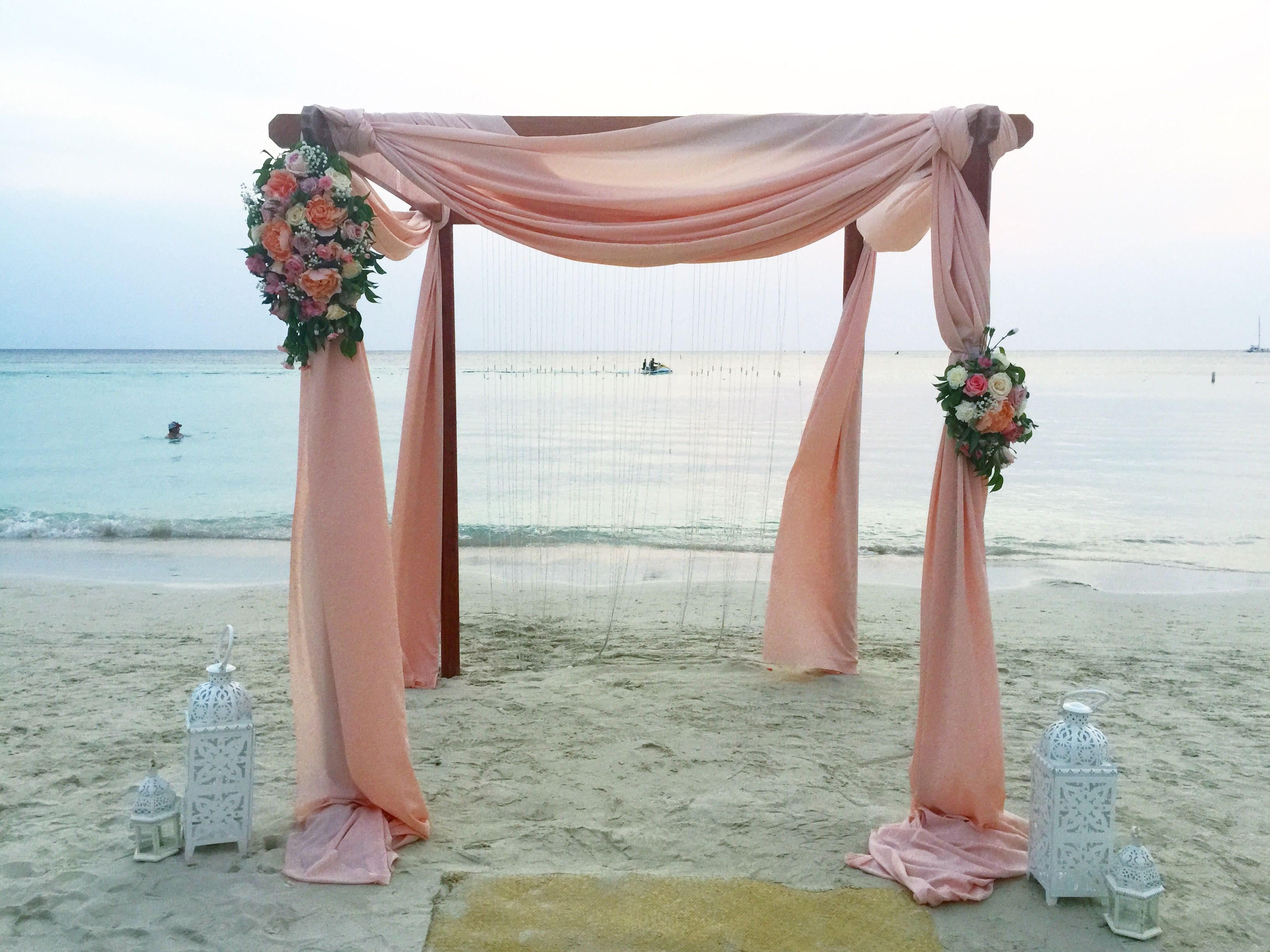 Beach wedding. Arch blush linens. Roatan. Roatan events