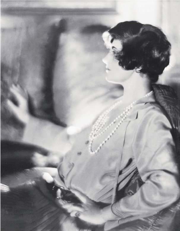 "Gabrielle Chanel with short hair, ca 1920, Photo By © CHANEL / All Rights Reserved. ""Fashion is not simply a matter of clothes. Fashion is in the air, born upon the wind. One intuits it. It is in the sky and on the road."""