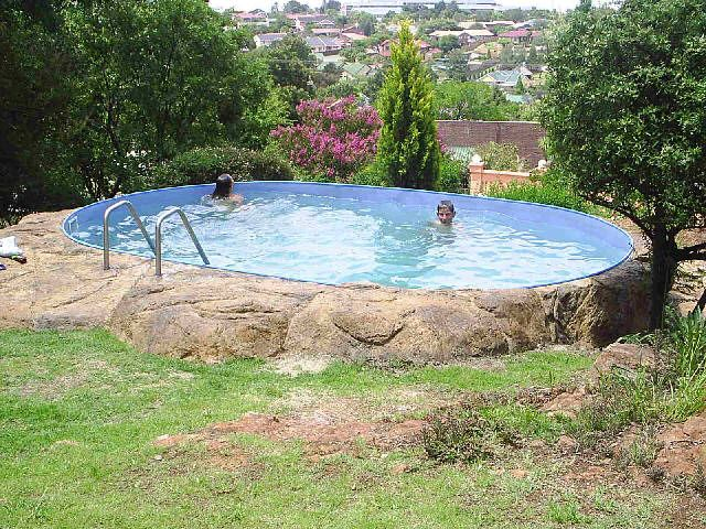 Above Ground Pool Ideas Backyard above ground pools like this one have all the amenities of an in ground Above Ground Pool On Sloped Yard Google Search Landscape Ideas Pinterest Ground Pools And Yards