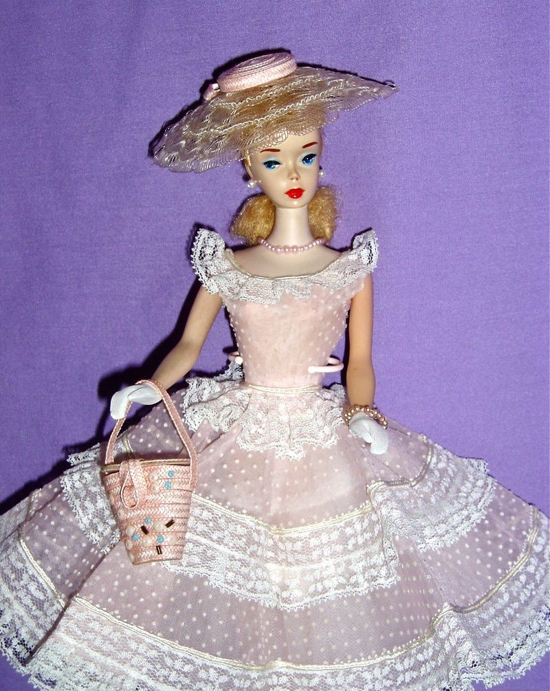 This is an original picture of the first Barbie styles. Barbie appeared in 1959, giving girls unreal beauty expectations.