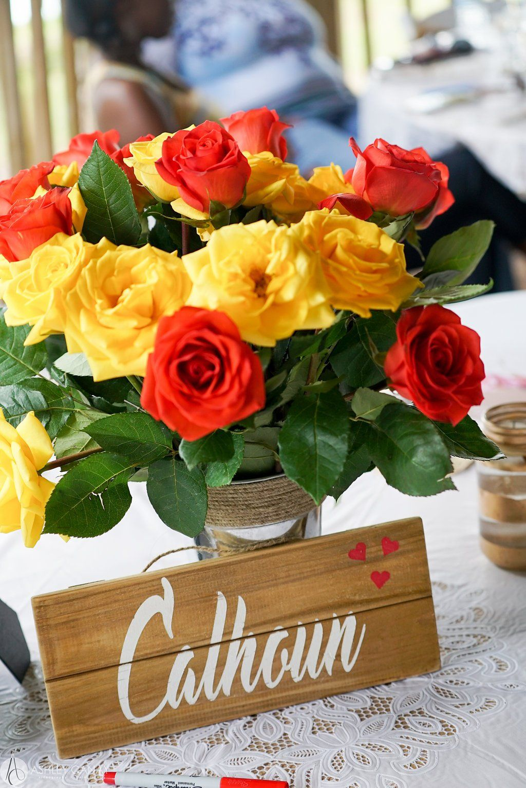 old mcmickys farm rustic barnyard bridal shower in tampa florida country styled centerpieces red and yellow roses wood sign