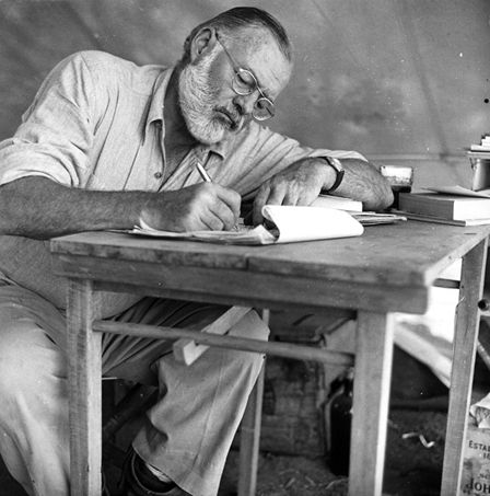 ernest hemingway writing in camp while on safari in kenya  1953