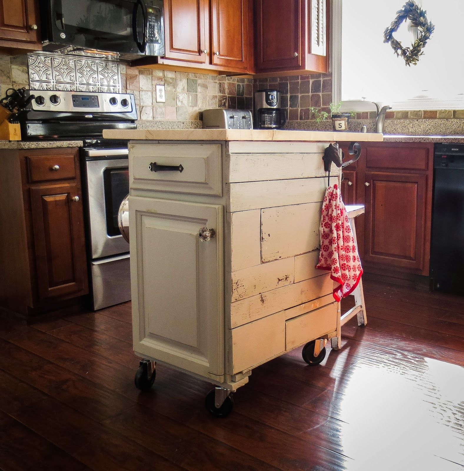 Re Purposed Cabinet Turned Into A Mobile Kitchen Cart The Top Is Spruce Wood That Looks Li Mobile Kitchen Island Modern Kitchen Storage Kitchen Cabinet Design