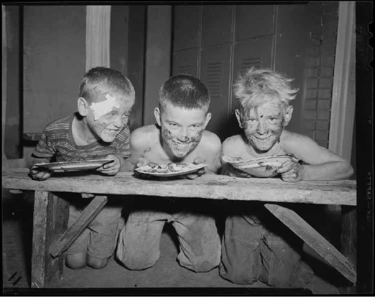 Three boys are enjoying a pie eating contest, 1954.
