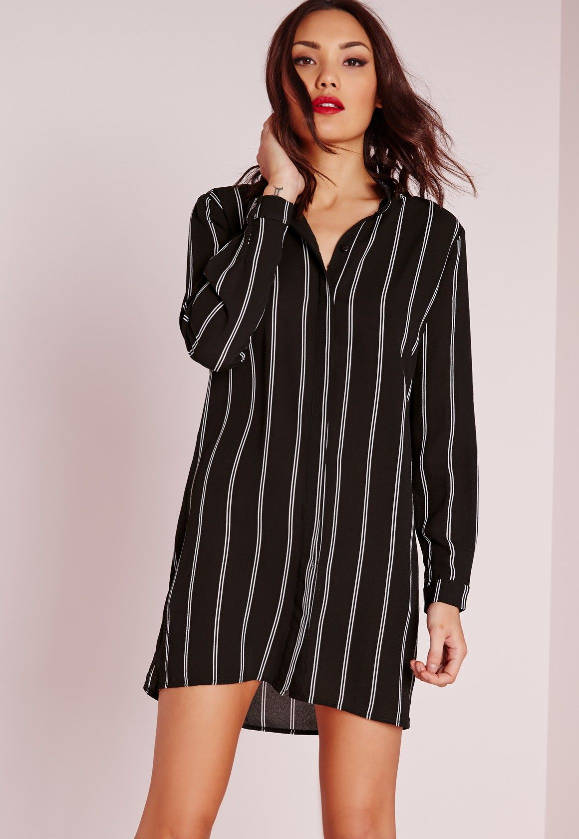 74a9057208d7b Keep your day style strong this season in this on point black striped shirt  dress.