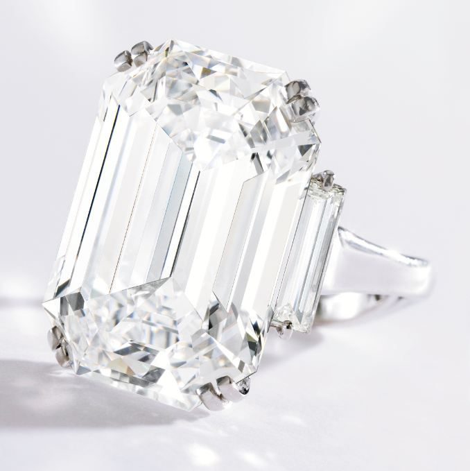Magnificent Platinum and Diamond Ring Estimate: 3,000,000 – 4,000,000 USD Centered by an emerald-cut diamond weighing 22.16 carats, flanked by two baguette diamonds weighing .98 carat, size 5, signed Graff. GIA report no. 5151045416 the diamond is D color, VVS1 clarity, with excellent polish and symmetry