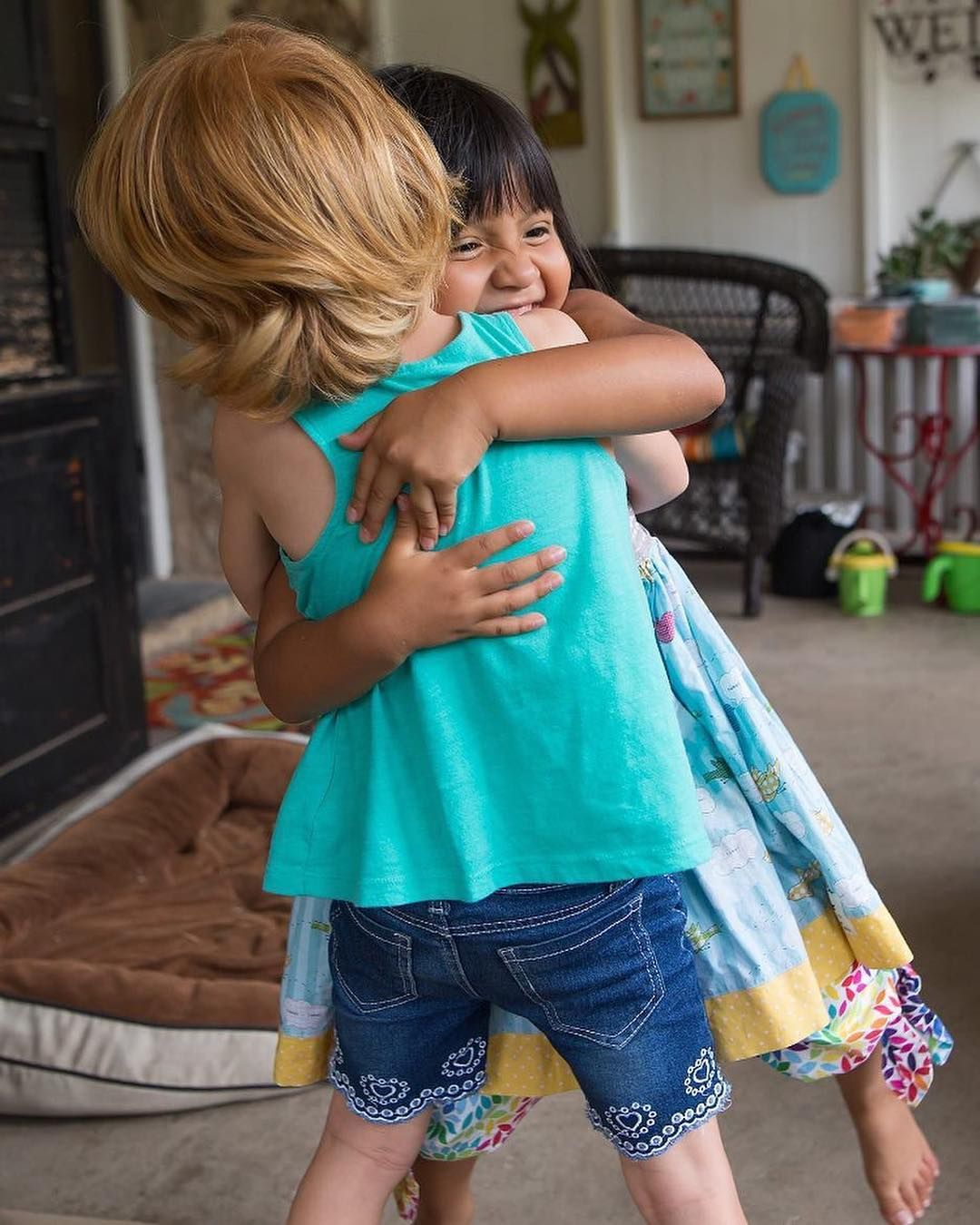 Two Young Friends Hug Goodbye During Their Last Playdate Before A