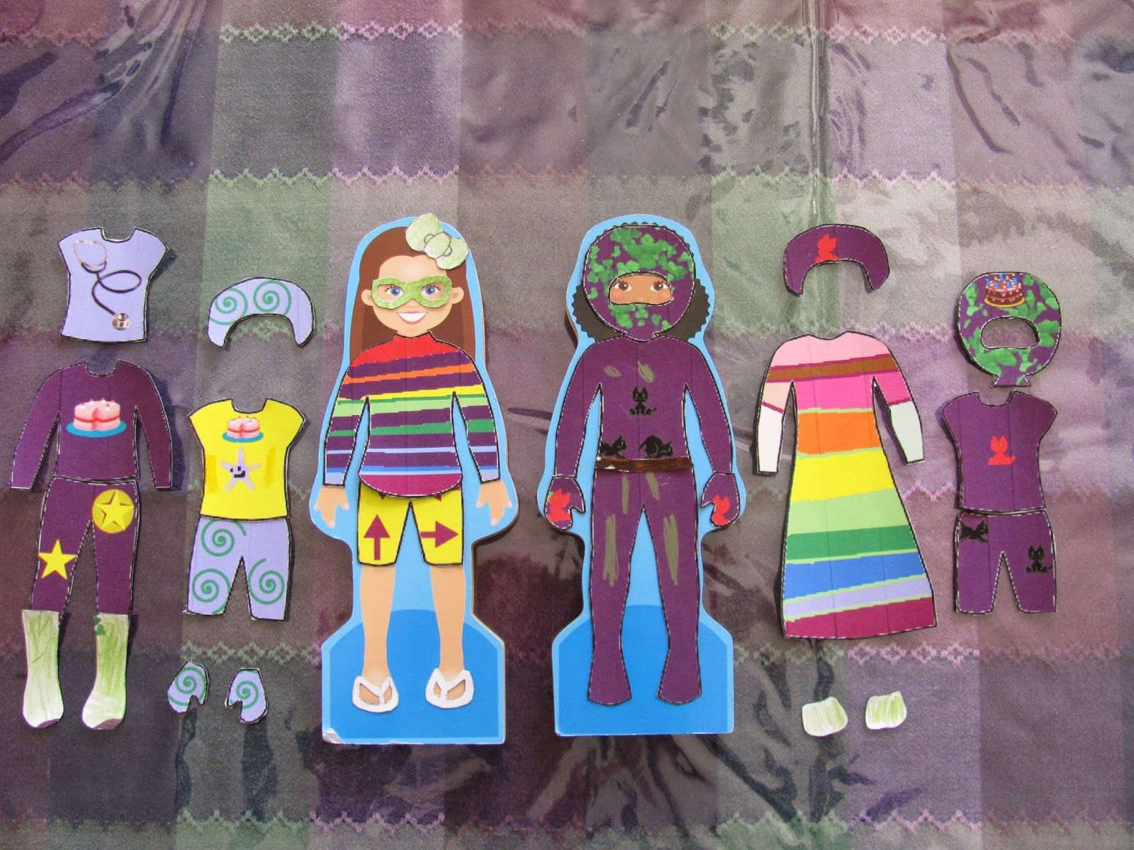 Printable Magnetic Paper Doll and Clothes!  Let the kids color in their own clothing designs.