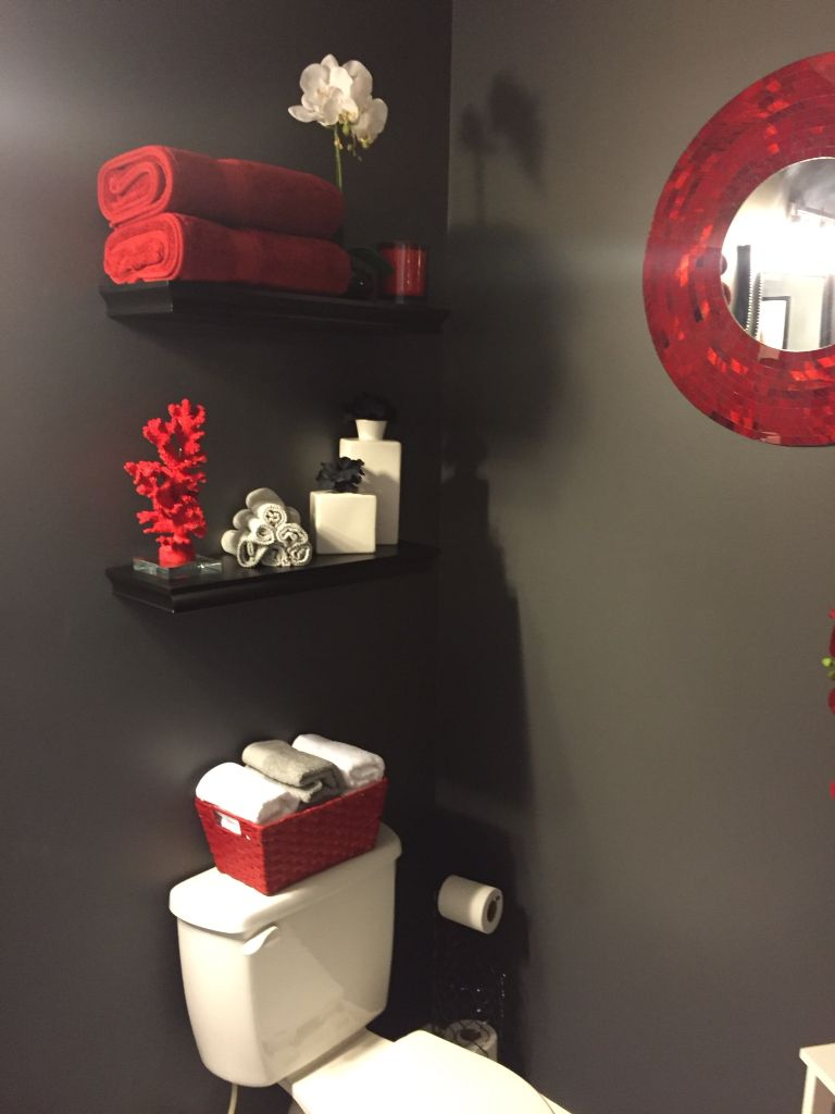 beautiful deep red bathroom featuring a mosaic mirror as