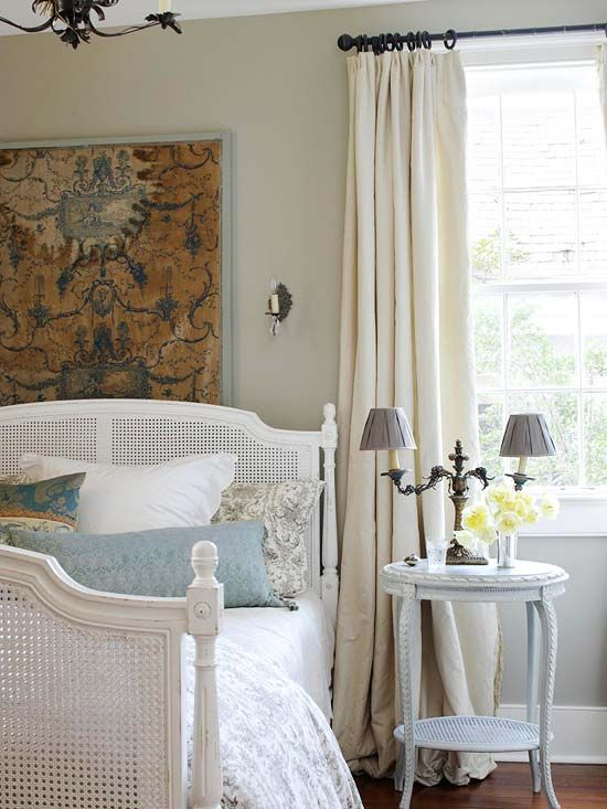 Merveilleux French Country Bedroom In Neutrals With Great Texture From The Hanging Rug  And Caned Bed. Accents Of Toile And Damask Pillows And Iron Cadelabra.