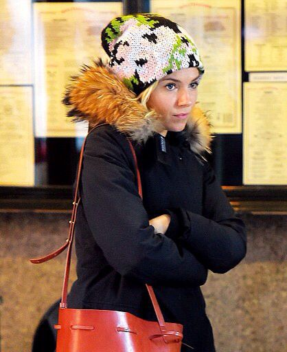 Sienna Miller wearing Tak.Ori Made in Italy Beanie Cortina flowers from  FallWinter 14 collection d0a36db2fc1