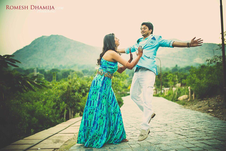 Cute Couple Udaipur Blue And Green Pre Wedding Pool Party Destination Wedding Pre Wedding Best Wedding Photographers Wedding Photographers
