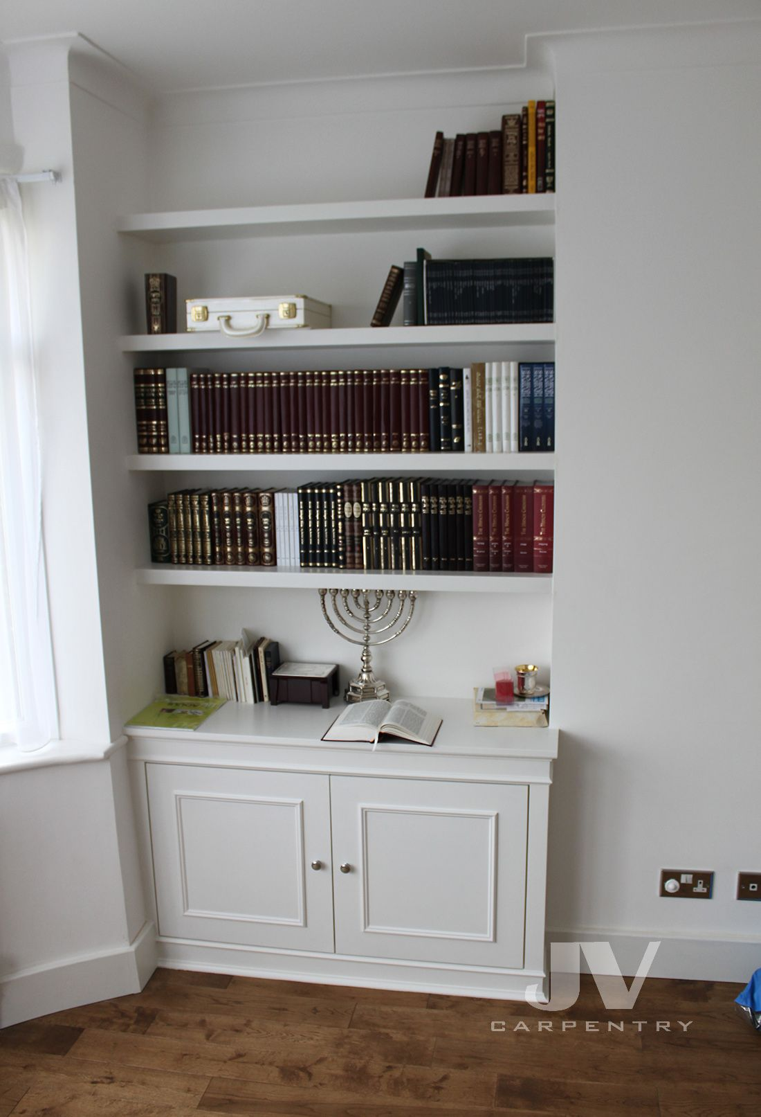 alcove floating shelves with cupboard at the bottom in ...