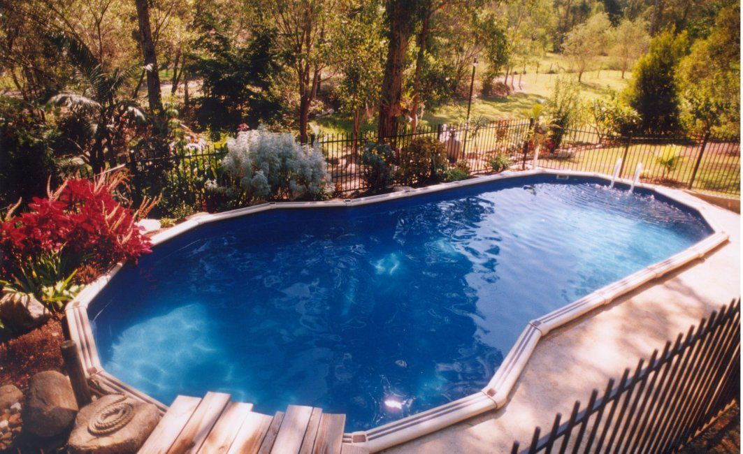 Above Ground Pool Keyhole Sunk Into The Ground Hot Tub Landscaping Pool Patio Above Ground Pool