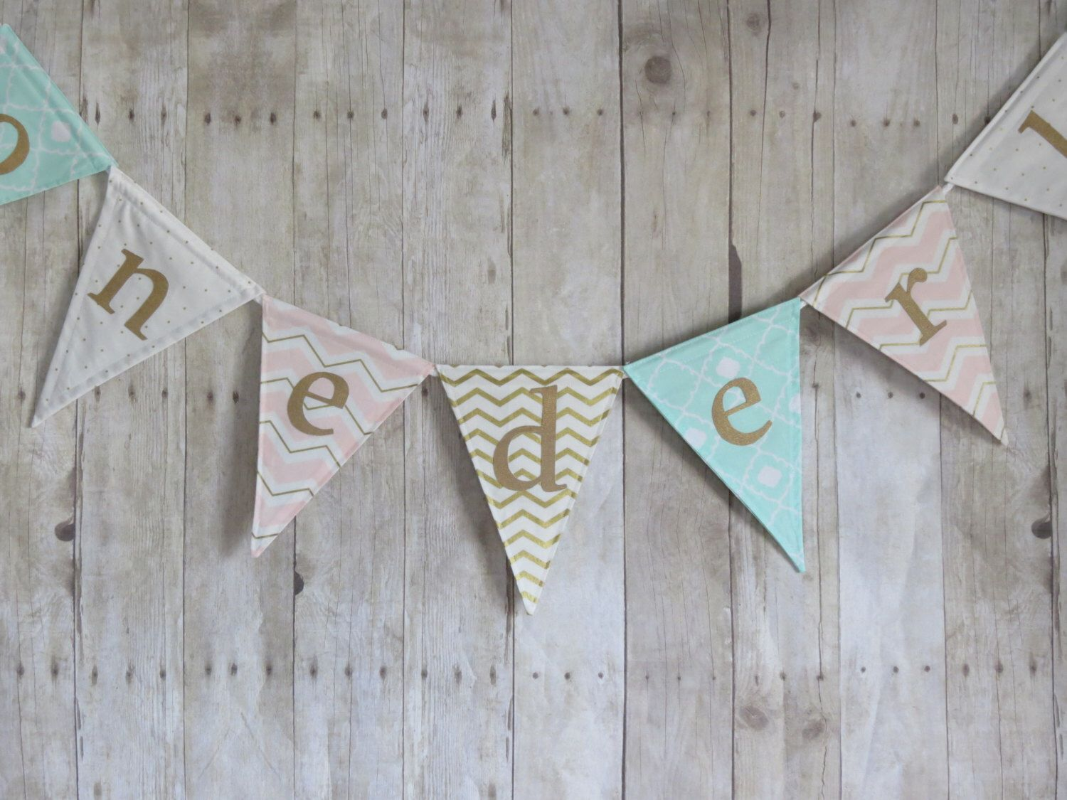 Custom flag banner. Mint, pink, and gold pennant banner. Personalize with a name or word, baby shower, nursery decor, birthday party decor by ThePartyOrchard on Etsy https://www.etsy.com/listing/245064189/custom-flag-banner-mint-pink-and-gold