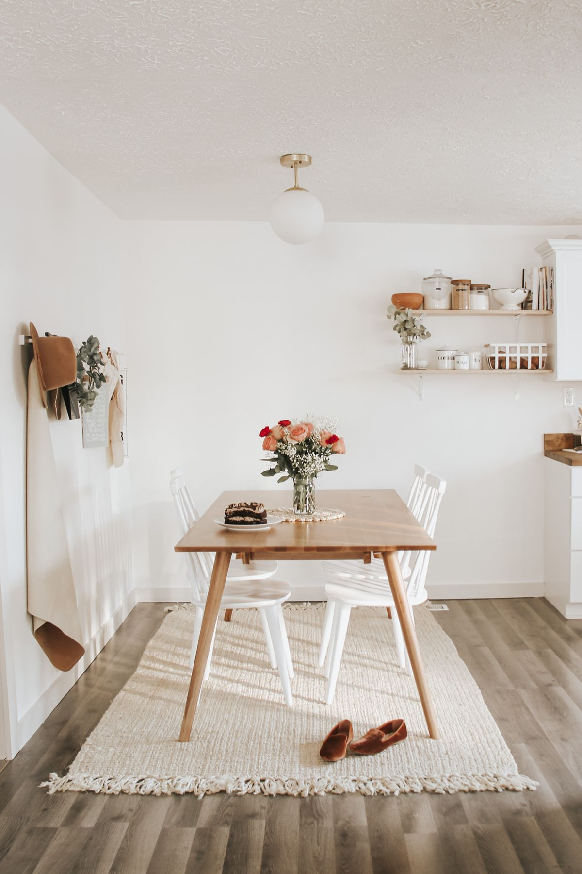 Dine Scandinavian style. Mix oaks with white for a light, bright, and cozy dining experience. Photo by Kenzie Salomon. #DiningRoomInspo #WoodTable #DiningRoomTable #InteriorIdeas