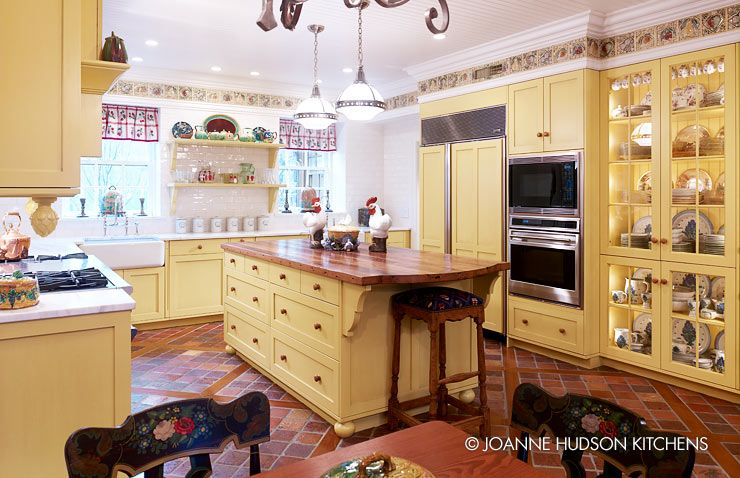 French Country kitchen w/terra cotta tiles embedded between wood