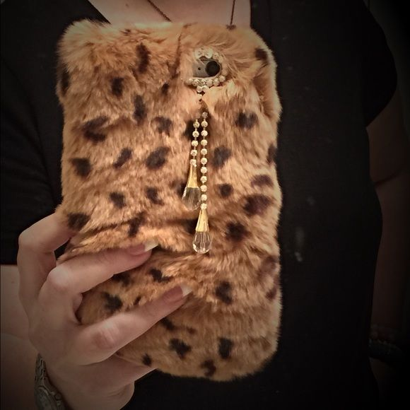 Fur Case IPhone 6plus Real rabbit fur IPhone 6 Plus case. Adorned with crystals around the camera lens and a cute bow and two crystal  tear drops hanging from it. Its plush and very soft.  It's never been used and original package included. Other