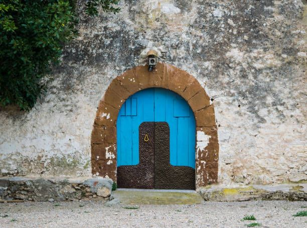 blue wooden door in the old spanish rural house