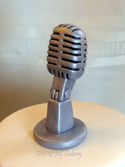 Old-style microphone made out of fondant on top of a cake ...