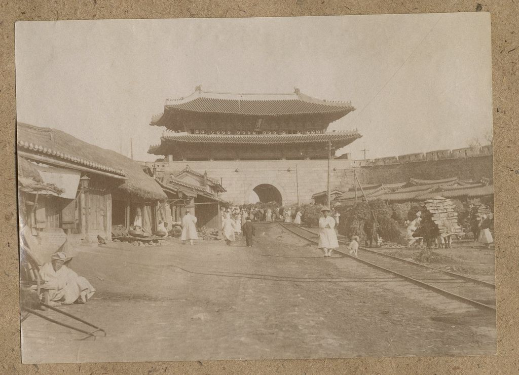 Collection: Willard Dickerman Straight and Early U.S.-Korea Diplomatic Relations, Cornell University Library. Title: [Seoul cityview] Date: ca. 1904 / 'Namdaemun' (Great South Gate in Seoul) is shown here with the tramtrails, which was instituted as a public transportion system in May 1899. 'Namdaemun', one of the 4 main gates of the old city wall, was completed in 1398 and underwent major restoration in 1447 and again in 1997.