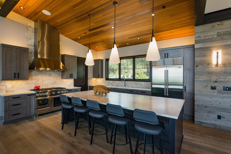 Modern Kitchen With Cedar Ceilings Artistic Pendant Lights