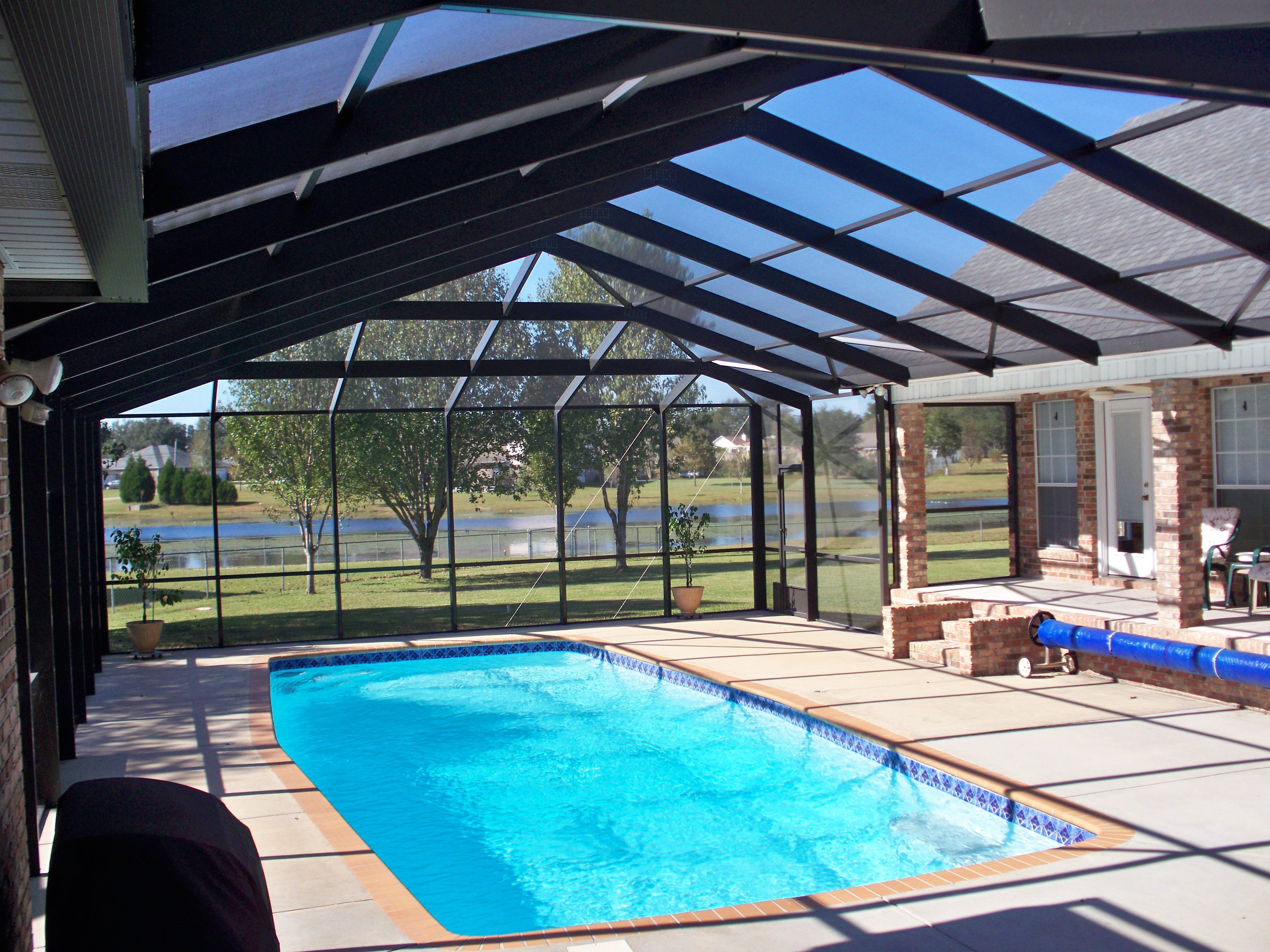 This Is A Bronze Pool Enclosure With A Gabled Roof We Installed Gnat Proof Screen To Keep The B Patio Builders Backyard Pool Designs Inground Pool Landscaping