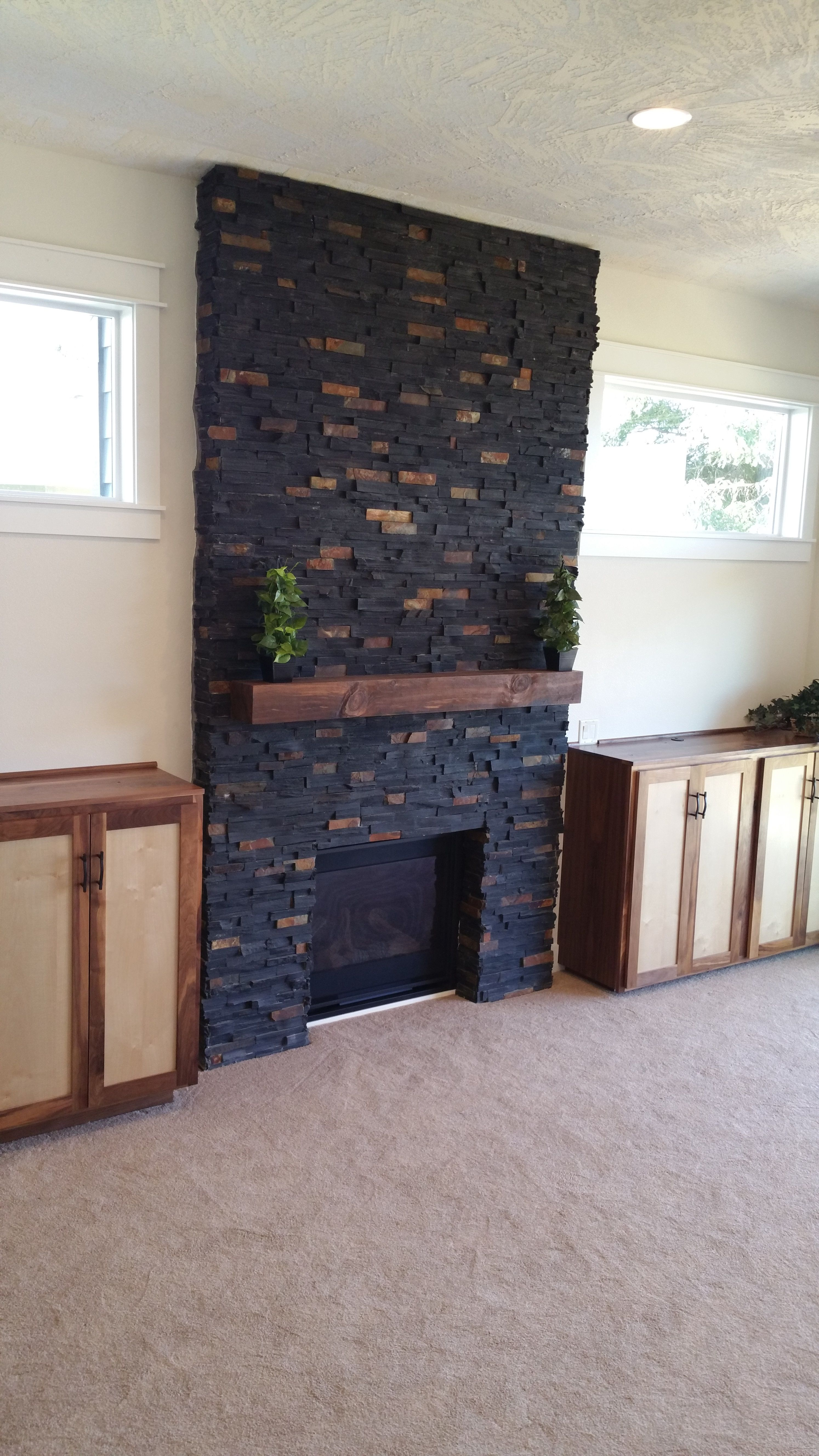 charcoal rust ledger stone accent wall and fireplace surround