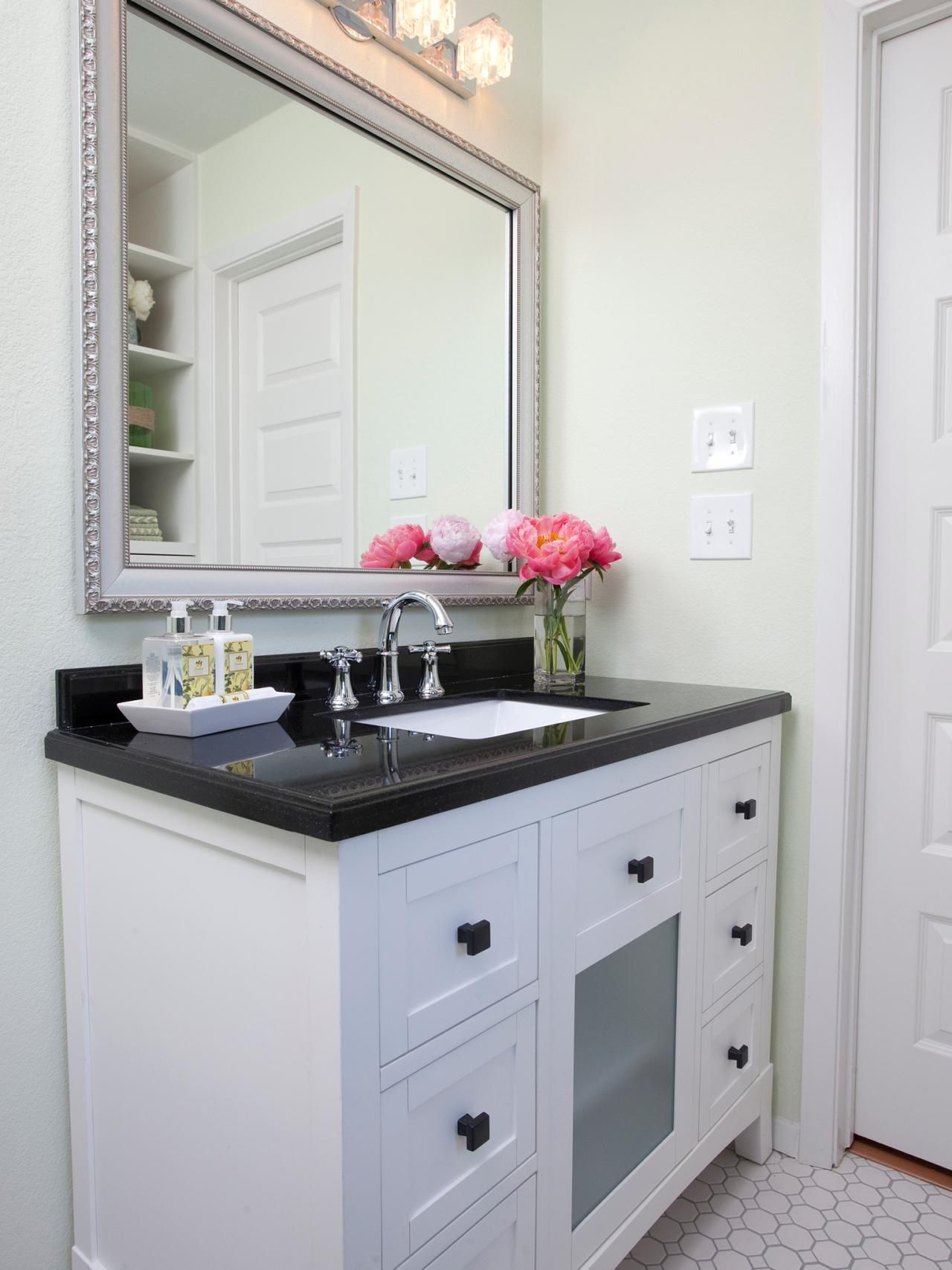A Black And White Vanity With Polished Countertop Has Plenty Of Counter E An Under Mounted Sink For Easy Cleanup