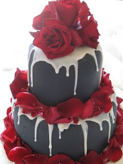 Black fondant with white chocolate drizzle..... This cake has been viewed many ways, classy, slightly Gothic, elegant, edgy?  What do you think?