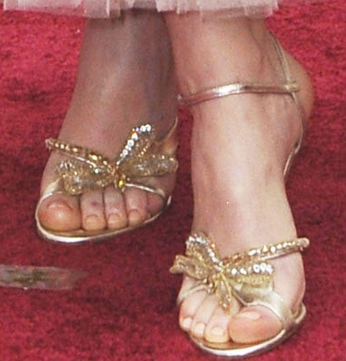 bb09946a276b61 Felicity wears the gorgeous Christian Louboutin Bat Bat sandals in gold