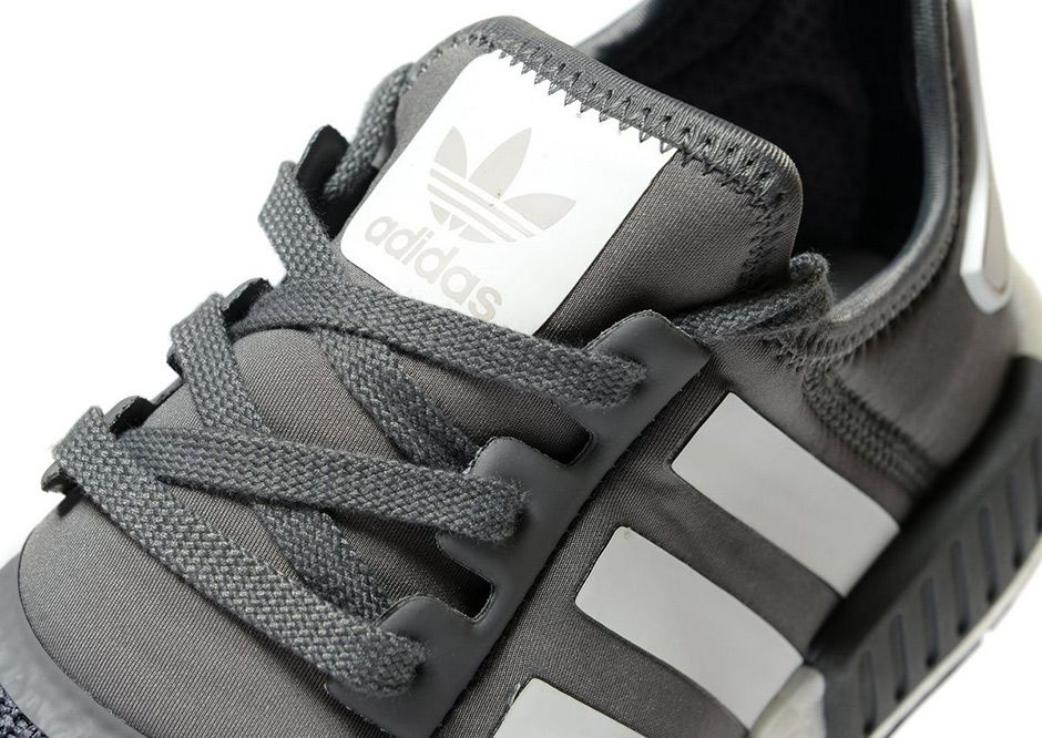 ac1cc7e493f48 JD Sports has the exclusive on a new adidas NMD R1 Dark Grey colorway  featuring mesh and neoprene along with the usual full-length Boost. More