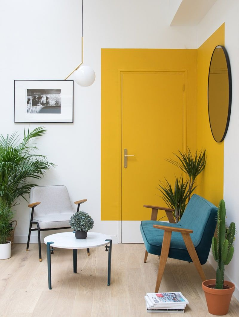 Love this yellow color block accent wall idea! Perfect way to add some interest to a white wall